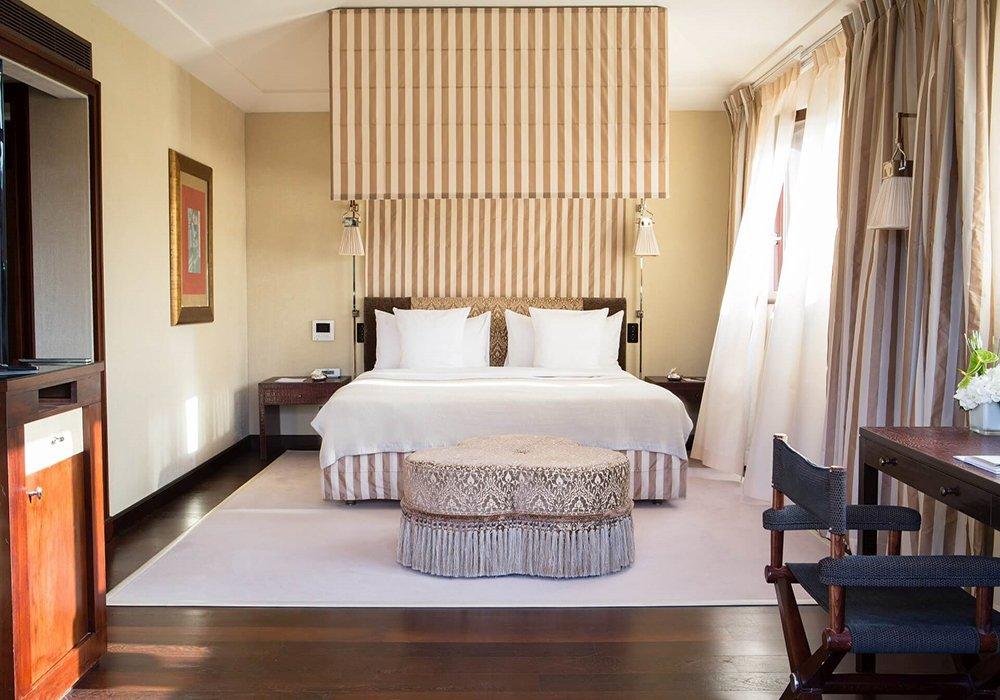 חדר שינה ומיטה במלון ספא לה רזרב בלוזאן - אגם ז'נבה