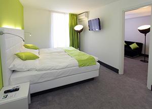 חדר שינה במלון hotel City Inn בבאזל